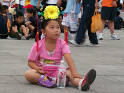 Little Girl Among The Crowd