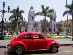 A Red Beetle Plaza De Las Armas