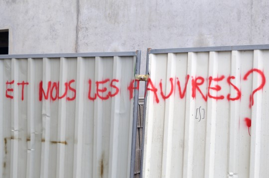 """What About Us, The Poor?"" Graffiti"
