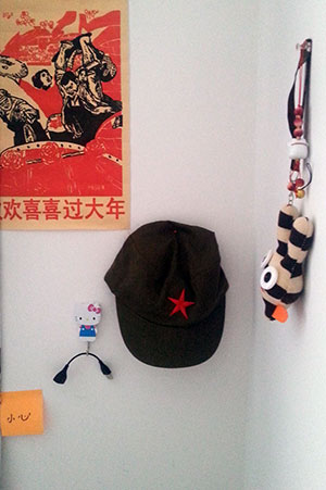 "Pinned above my desk: Mao-era propaganda, communist hat and ""cute"" stuff"