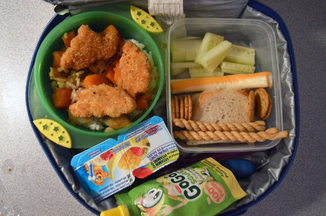 Rice, broccoli, carrots, chicken nuggets / Jam sandwich / Cucumber / Veggie crackers / String cheese / Chinese sesame cookies / Two yogurts / Apple sauce