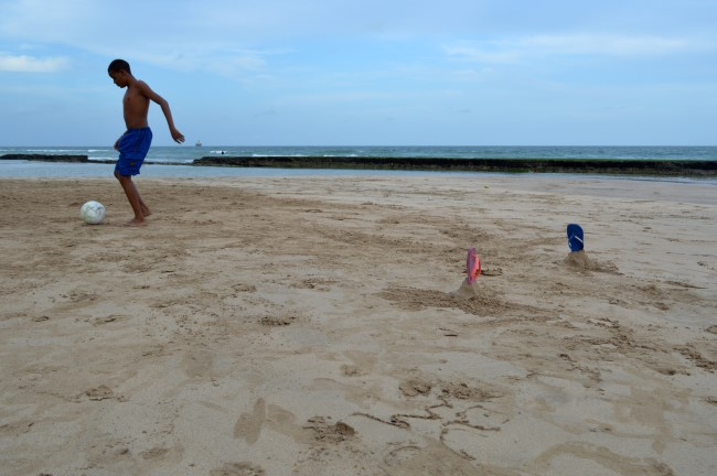 Football + beach + sandals marking goal post = Brazil