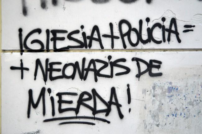 """Church + police = shitty neonazi"", found on calle 25 de Mayo"