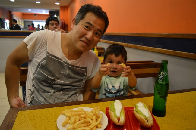 Mark and Feng tasting the hot dog and fries combo