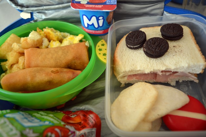 Spring rolls, fried tofu, eggs and white rice // Cream cheese and ham sandwich on Italian bread // Shrimp crackers // Babybel cheese // Mini-Oreos // Apple sauce and yogurt