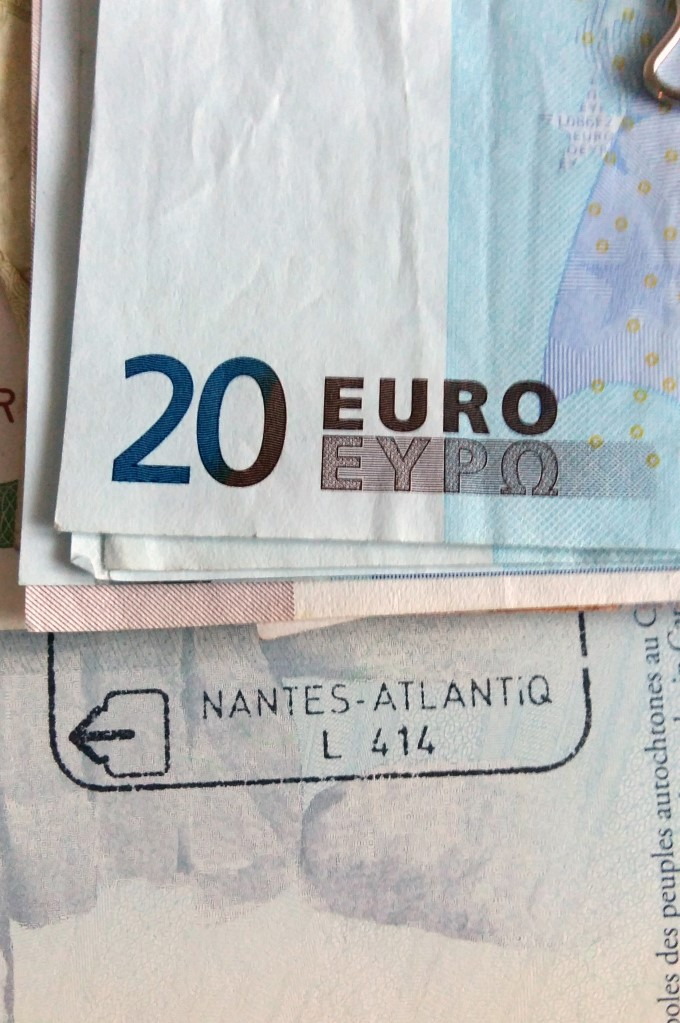 Euro banknotes and passport