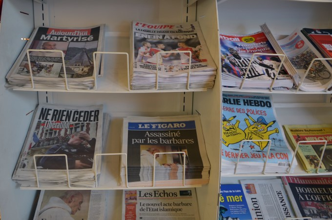 Newspaper headlines the morning after the priest was murdered