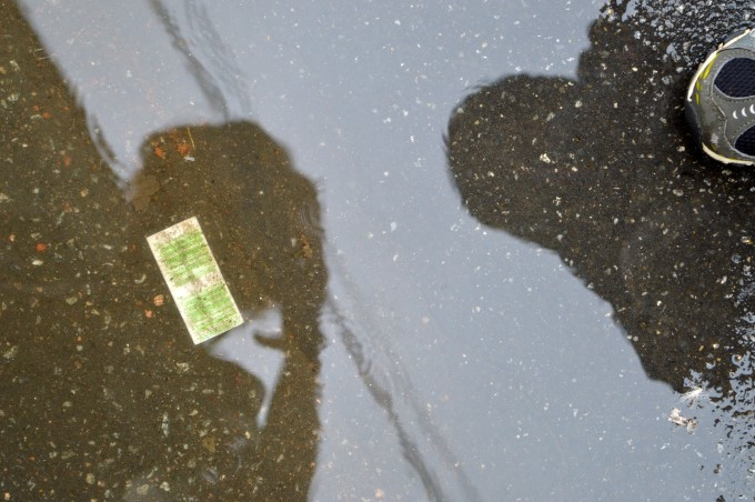 Self portrait in a puddle of rain water with Mark