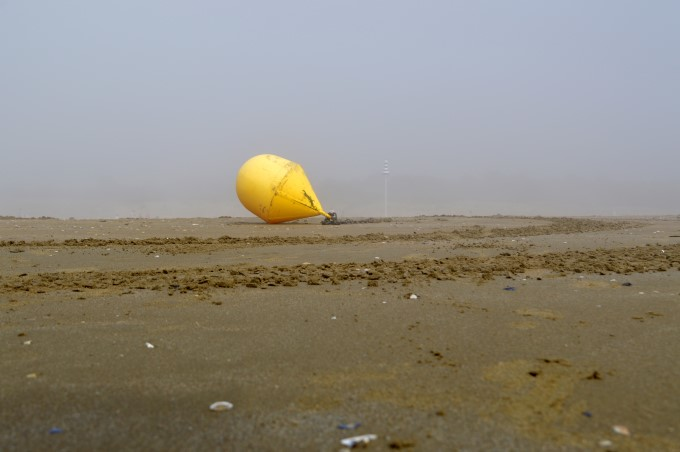 Buoy on the sand