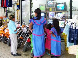 Kuna Kids Watching T.V In The Street, Panama