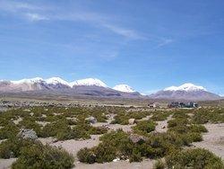 Volcanoes And Snowy Peaks