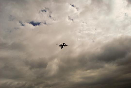 Plane in a Stormy Sky