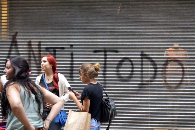 """Against Everything"" Graffiti and Shoppers in Montevideo"