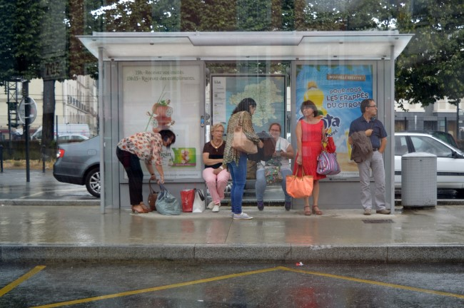 Waiting for the bus under the rain