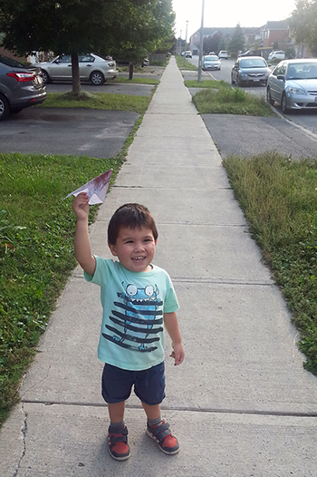 Mark flying a paper airplane, Ottawa, September 2015