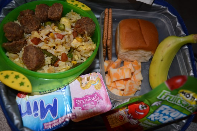 Stir-fried rice with veggies and meatballs, honey sandwich, butter cookies, cheese, banana, yogurts and apple sauce