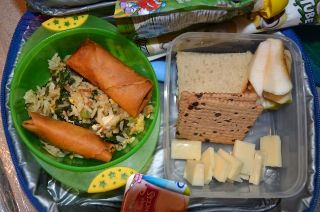 Stir-fried rice with spinach and bok choy, spring rolls, cheese, sandwich, apple, butter cookies, yogurt and apple sauce