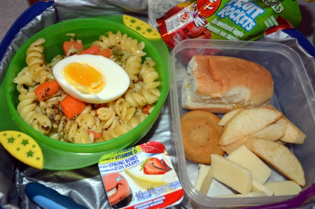 Pasta with carrots and broccoli with a pesto sauce and egg, apple, cheese, cream cheese-filing cookie, yogurt and apple sauce