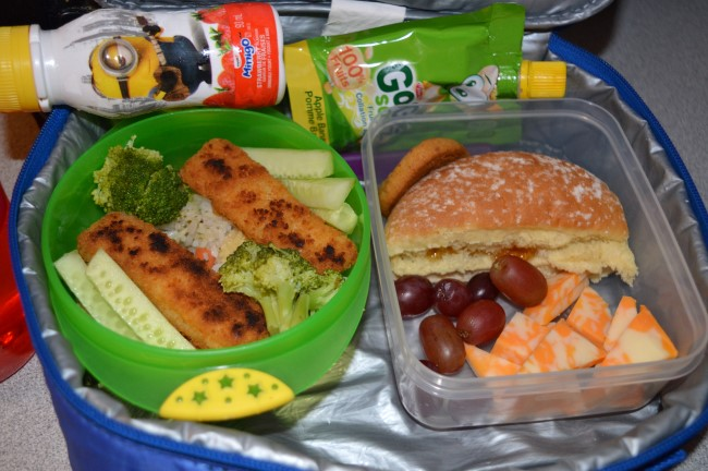 Stir-fried rice with broccoli, carrots and cucumber with breaded fish, italian bun with peach jam, grapes, cheese, yogurt and apple sauce