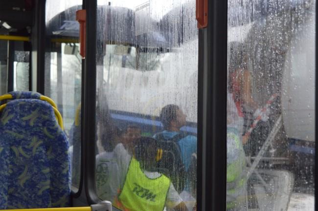 Bording the plane under the rain