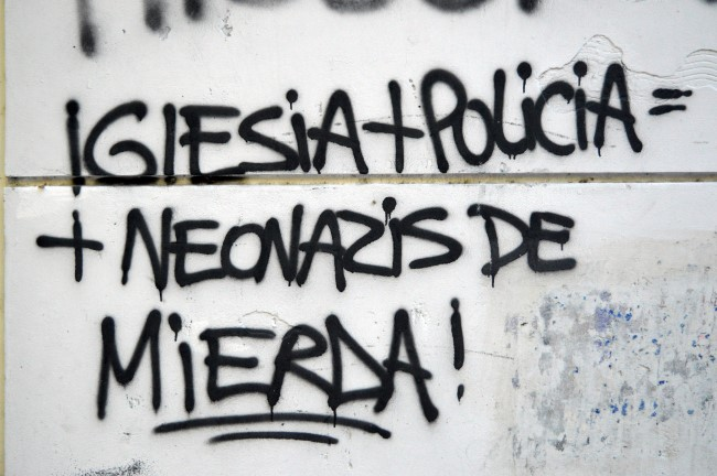 """Church + police = shitty neonazi"", found on calle 25 de Mayo"