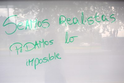 """Be realistic: demand the impossible"" (Graffiti in Santiago)"