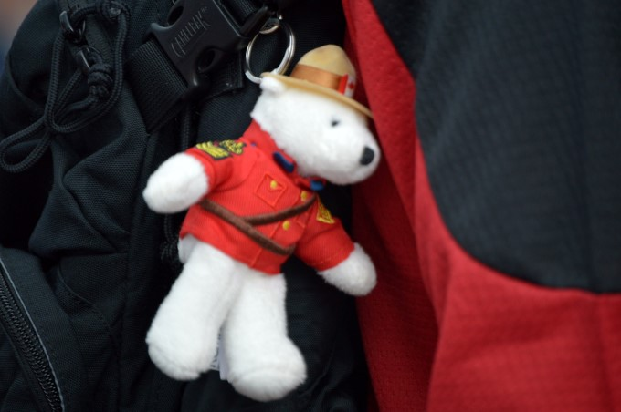 Little mountie bear in the crowd