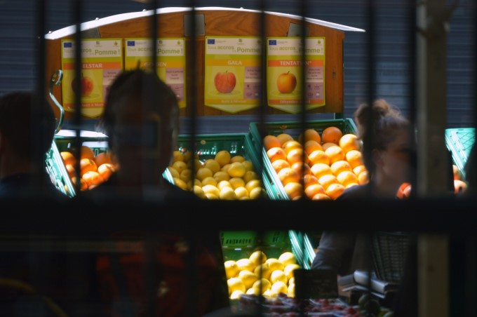 The fruits and veggie stalls outside, from inside the market