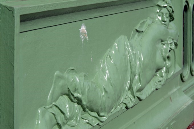 Naked woman, bas-relief on a bridge