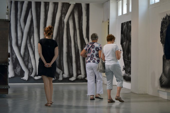 Visitors in an art exhibition