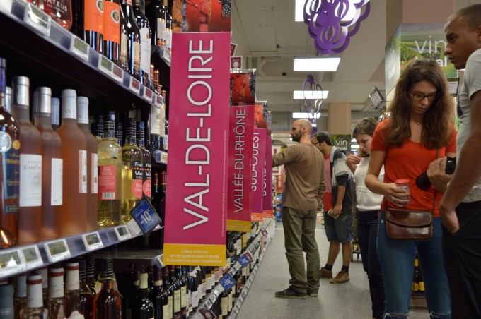Shoppers choosing wine at the supermarket