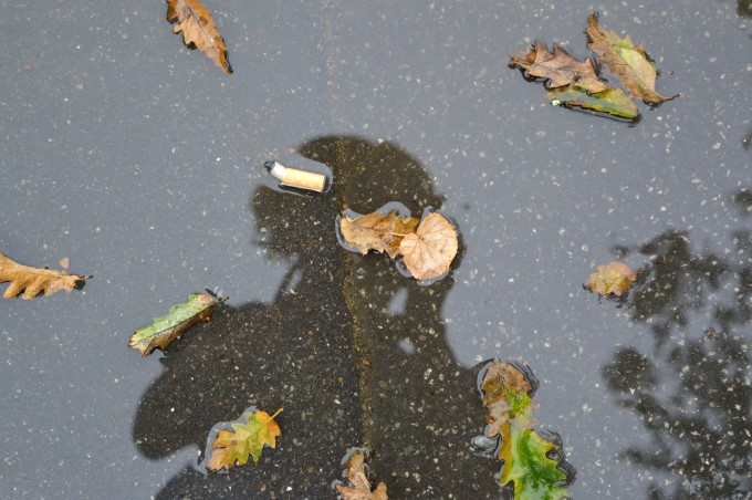 Self portrait in a puddle of rain water