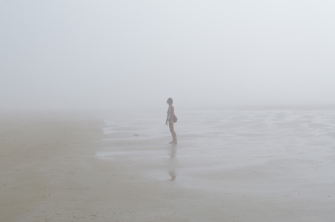 In the heavy mist on the beach