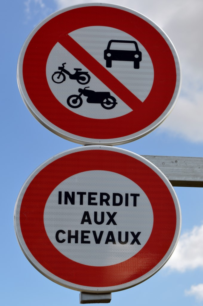 "Sign in Saint-Michel along the main national road, ""forbidden to horses"""