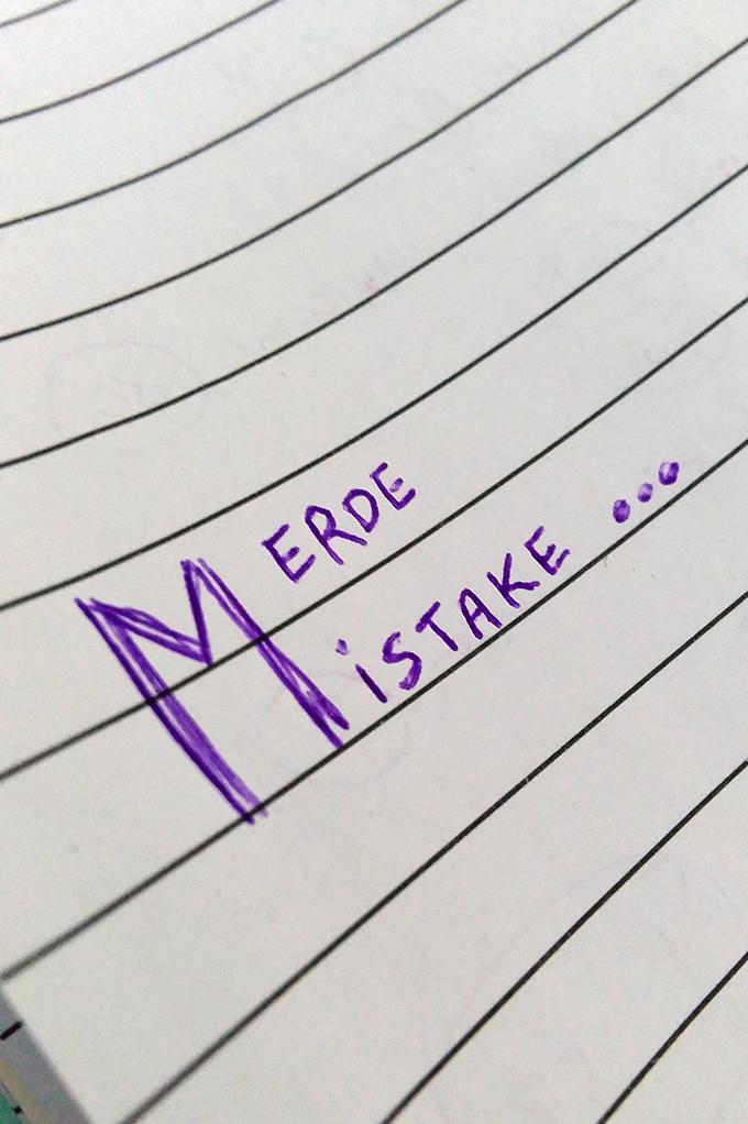 Merde. Mistake.