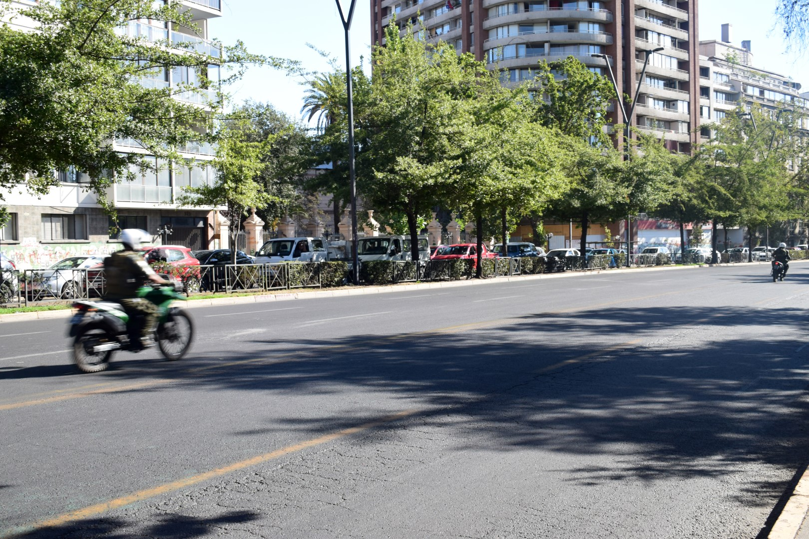 Military police speeding down Avenida Providencia, Santiago